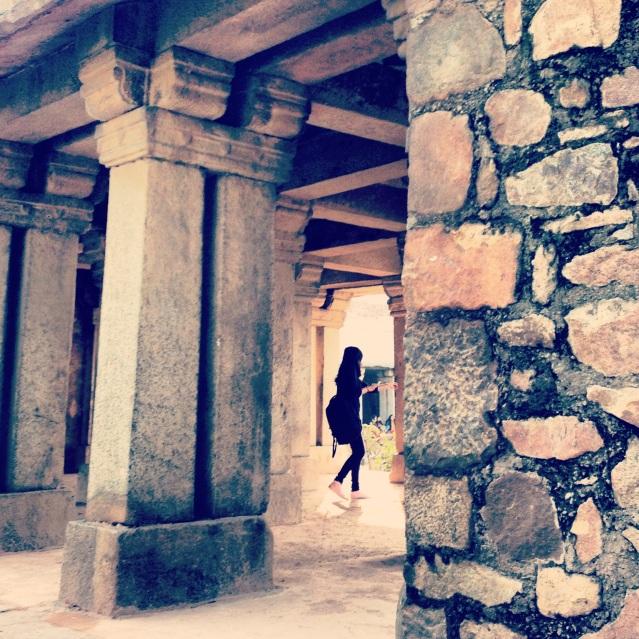 Between the ancient pillars at Hauz Khas Village, Delhi, India